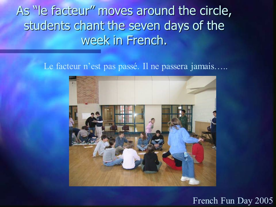As le facteur moves around the circle, students chant the seven days of the week in French.