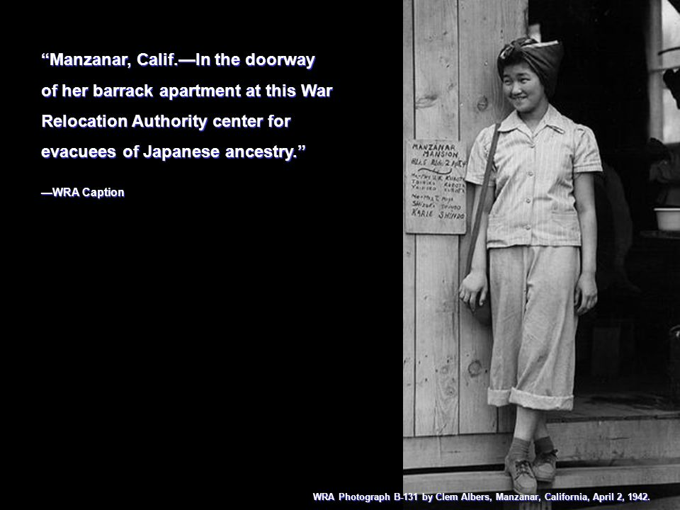 Manzanar, Calif.In the doorway of her barrack apartment at this War Relocation Authority center for evacuees of Japanese ancestry. WRA Caption Manzana