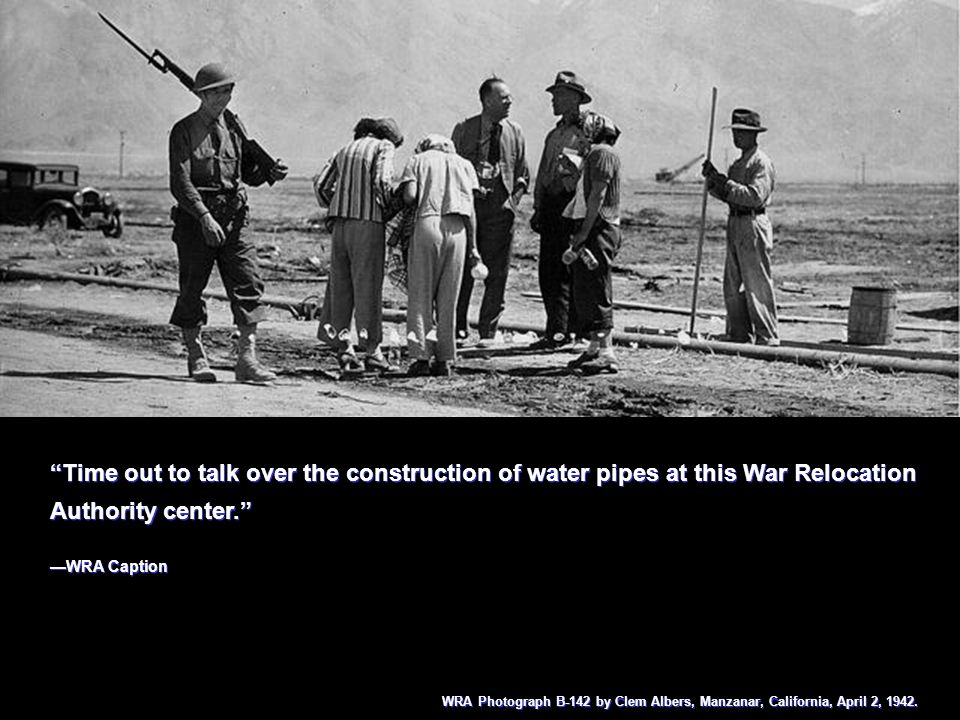 Time out to talk over the construction of water pipes at this War Relocation Authority center. WRA Caption Time out to talk over the construction of w