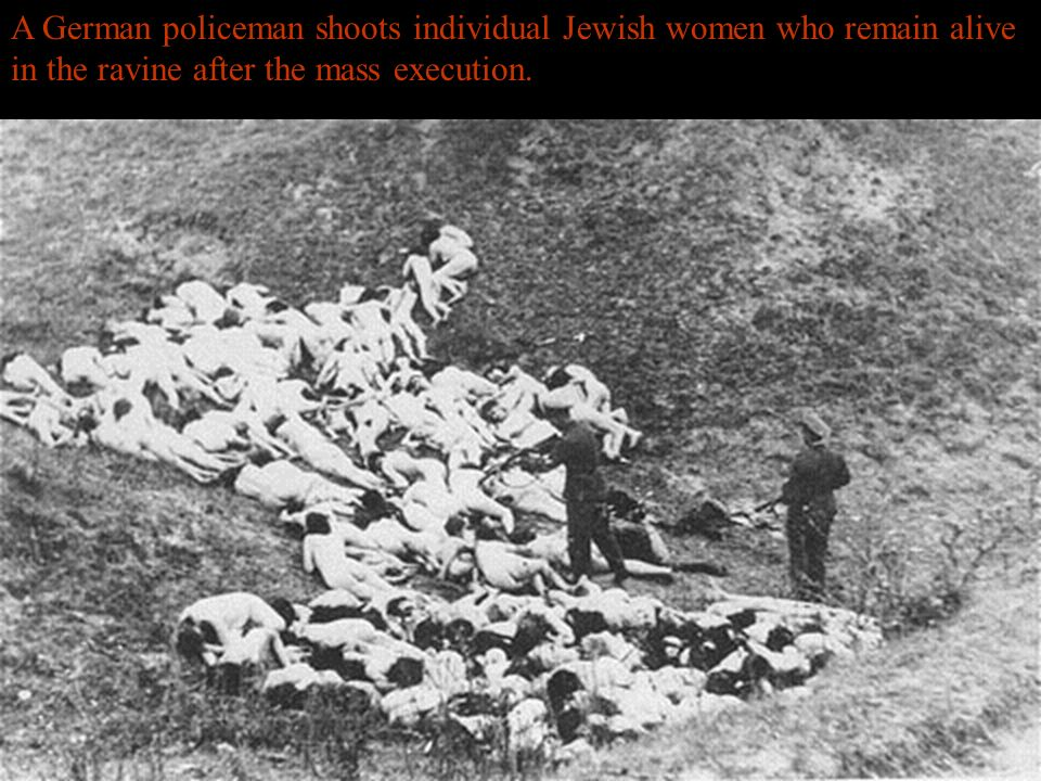 Jewish women, some holding infants, are forced to wait in a line before their execution by Germans and Ukrainian collaborators.