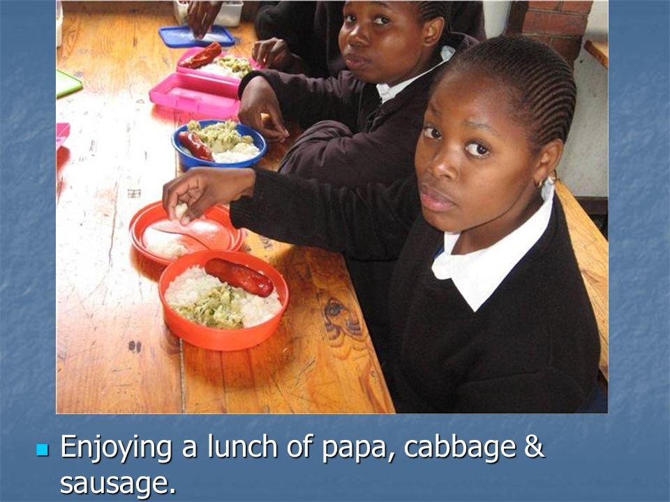 Enjoying a lunch of papa, cabbage & sausage. Enjoying a lunch of papa, cabbage & sausage.