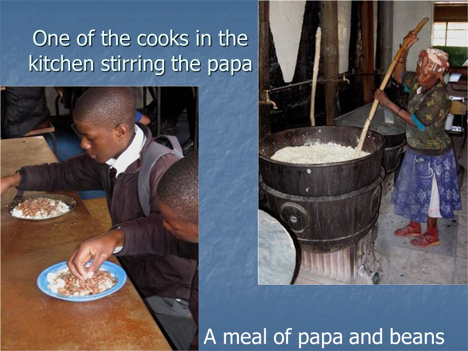 One of the cooks in the kitchen stirring the papa A meal of papa and beans