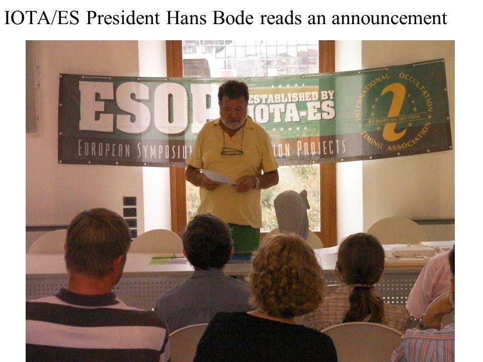 IOTA/ES President Hans Bode reads an announcement