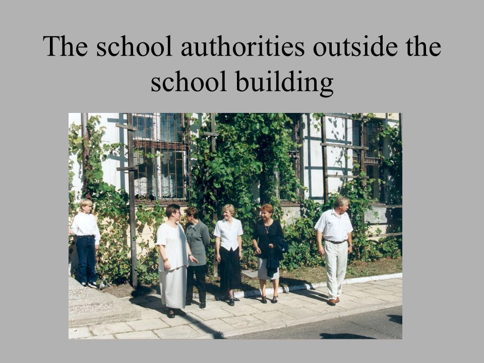 The school authorities outside the school building