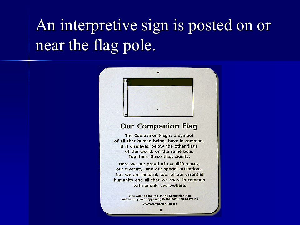 An interpretive sign is posted on or near the flag pole.