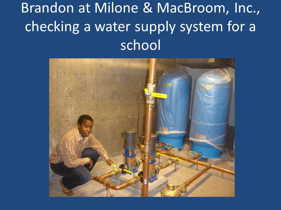 Brandon at Milone & MacBroom, Inc., checking a water supply system for a school
