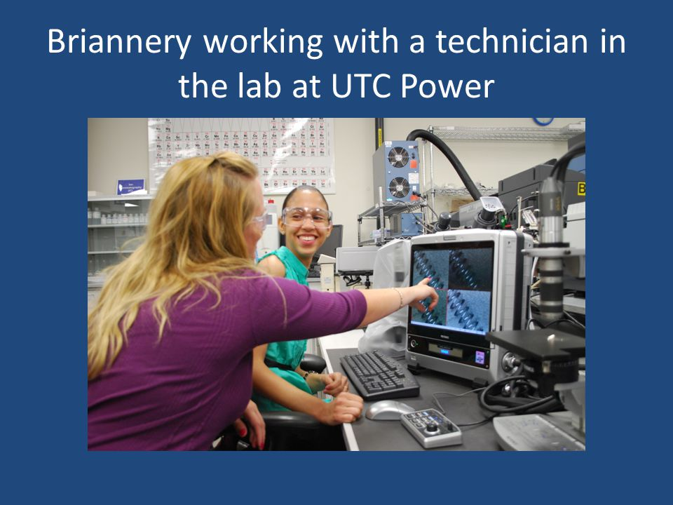 Briannery working with a technician in the lab at UTC Power