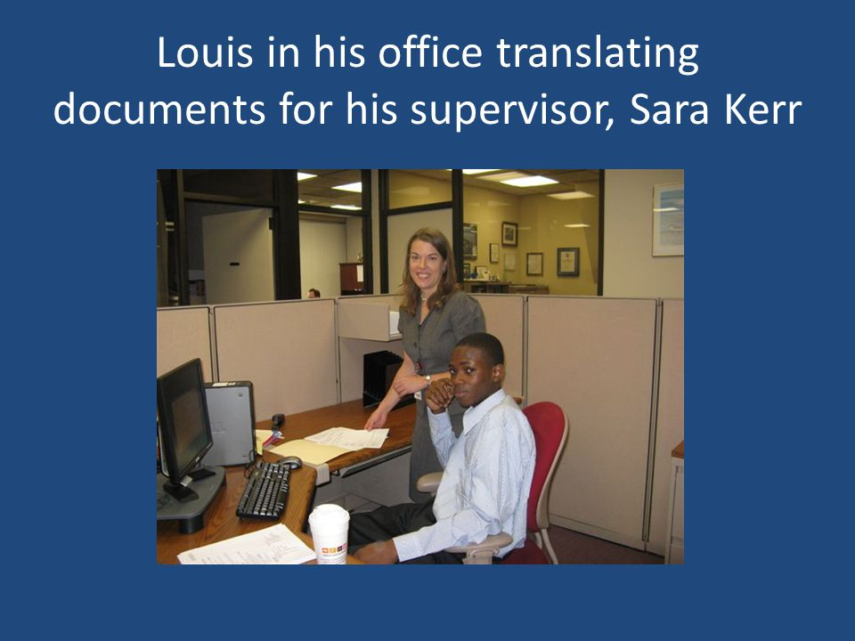 Louis in his office translating documents for his supervisor, Sara Kerr