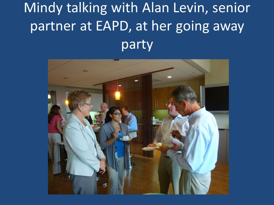 Mindy talking with Alan Levin, senior partner at EAPD, at her going away party