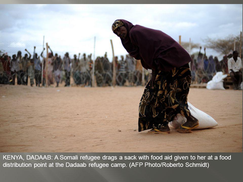 KENYA, DADAAB: Somali refugees lead their herds of goats home for the night, inside Dagahaley Camp, outside Dadaab, Kenya.
