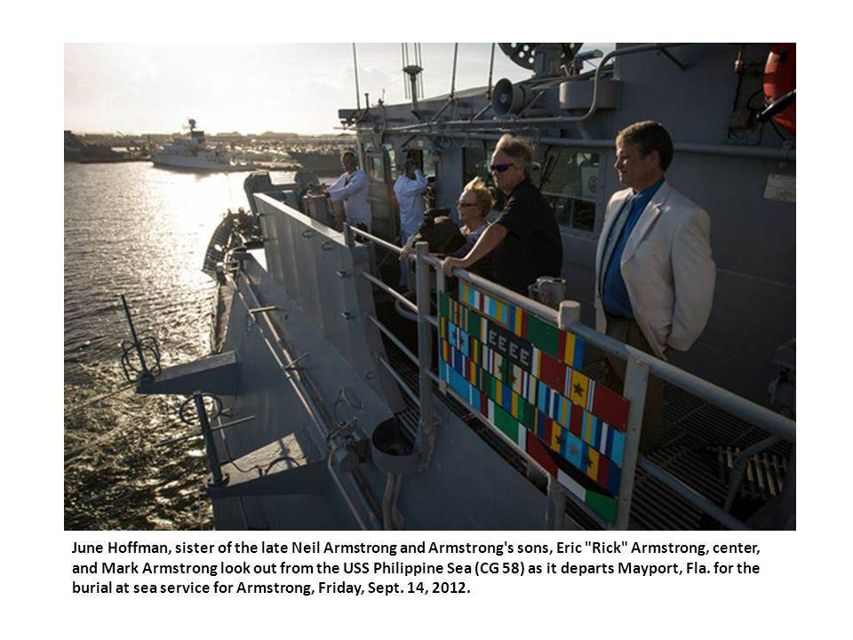 June Hoffman, sister of the late Neil Armstrong and Armstrong s sons, Eric Rick Armstrong, center, and Mark Armstrong look out from the USS Philippine Sea (CG 58) as it departs Mayport, Fla.