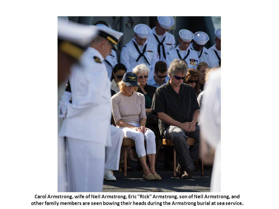 Carol Armstrong, wife of Neil Armstrong, Eric Rick Armstrong, son of Neil Armstrong, and other family members are seen bowing their heads during the Armstrong burial at sea service.