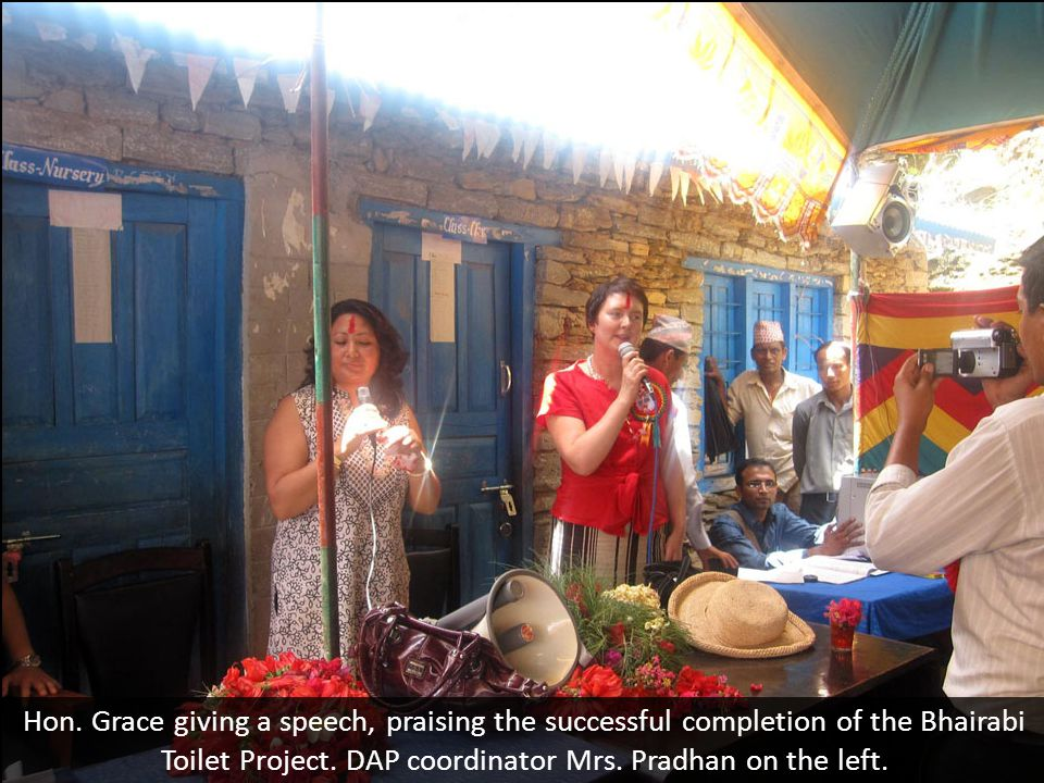 Hon. Grace giving a speech, praising the successful completion of the Bhairabi Toilet Project.