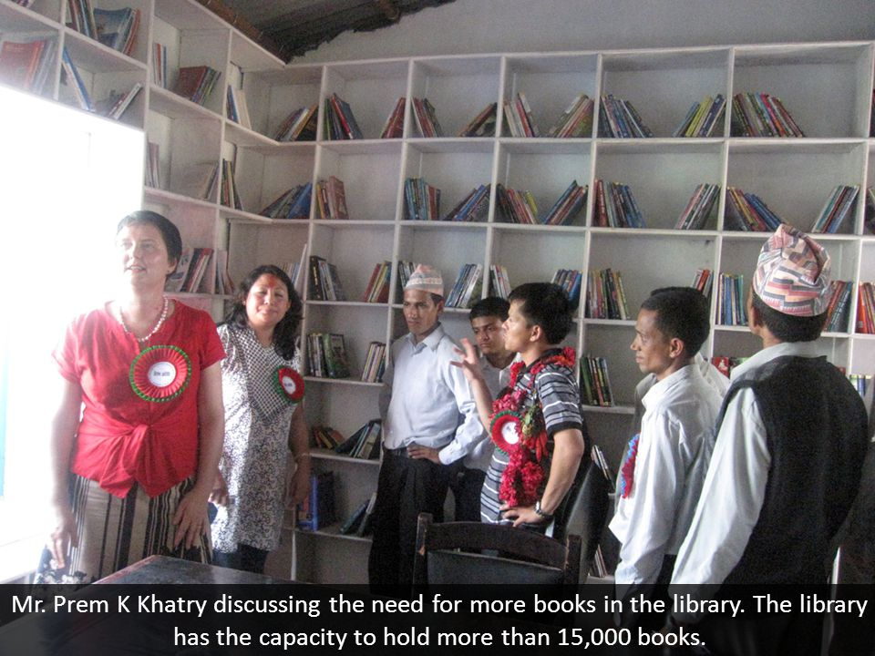 Mr. Prem K Khatry discussing the need for more books in the library.