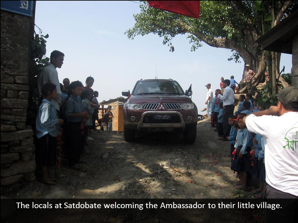 The locals at Satdobate welcoming the Ambassador to their little village.