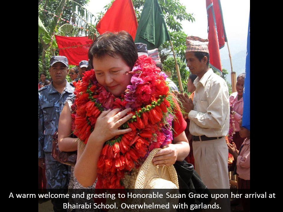 A warm welcome and greeting to Honorable Susan Grace upon her arrival at Bhairabi School.