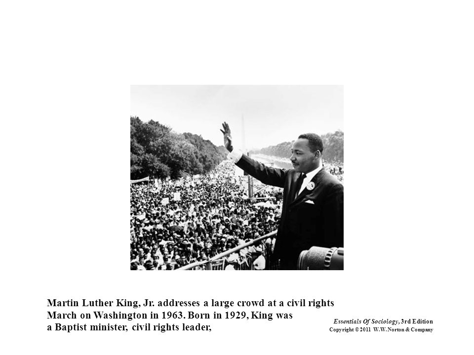 Martin Luther King, Jr. addresses a large crowd at a civil rights March on Washington in 1963. Born in 1929, King was a Baptist minister, civil rights