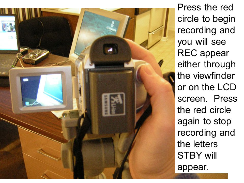 Press the red circle to begin recording and you will see REC appear either through the viewfinder or on the LCD screen.