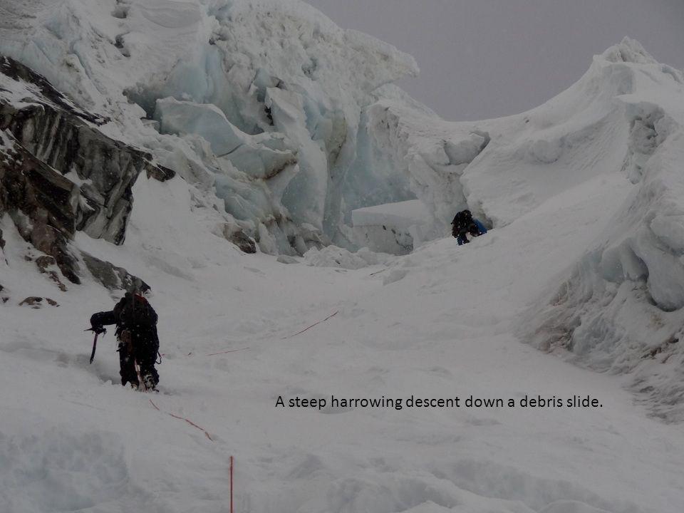 A steep harrowing descent down a debris slide.