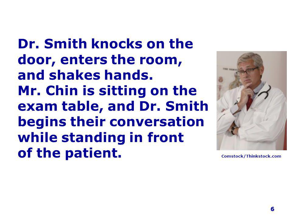 Dr. Smith knocks on the door, enters the room, and shakes hands.