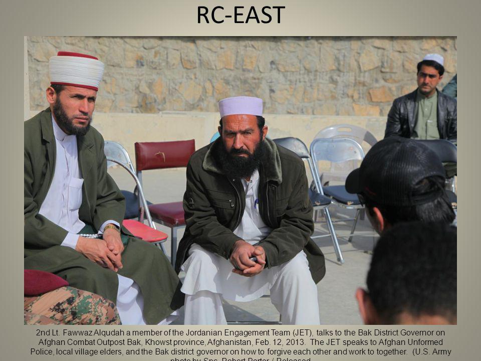 RC-EAST 2nd Lt. Fawwaz Alqudah a member of the Jordanian Engagement Team (JET), talks to the Bak District Governor on Afghan Combat Outpost Bak, Khows