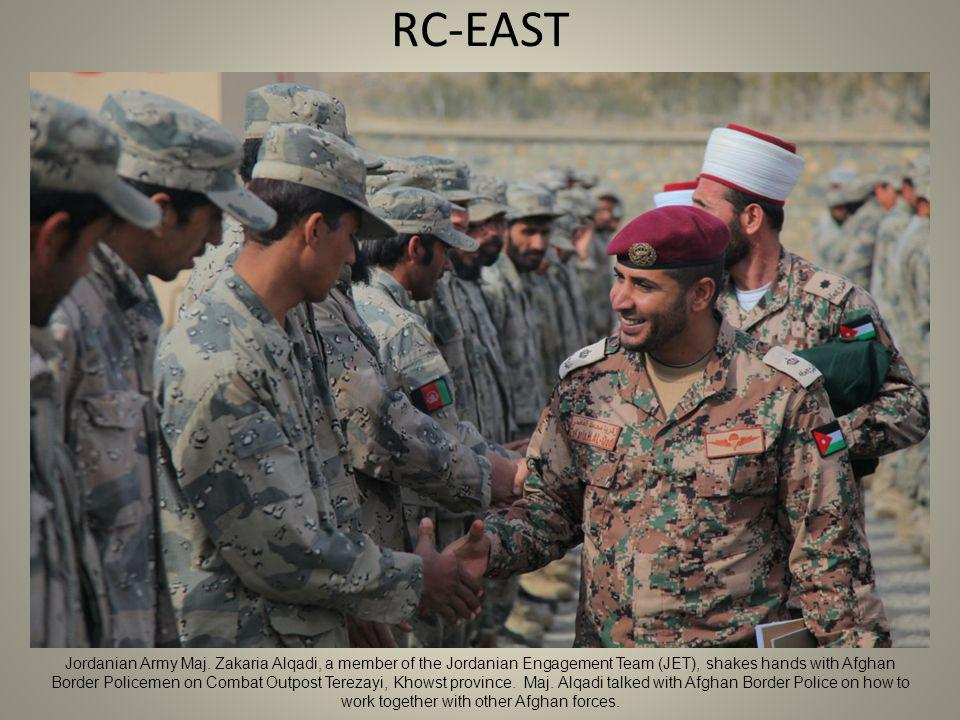 RC-EAST Jordanian Army Maj. Zakaria Alqadi, a member of the Jordanian Engagement Team (JET), shakes hands with Afghan Border Policemen on Combat Outpo