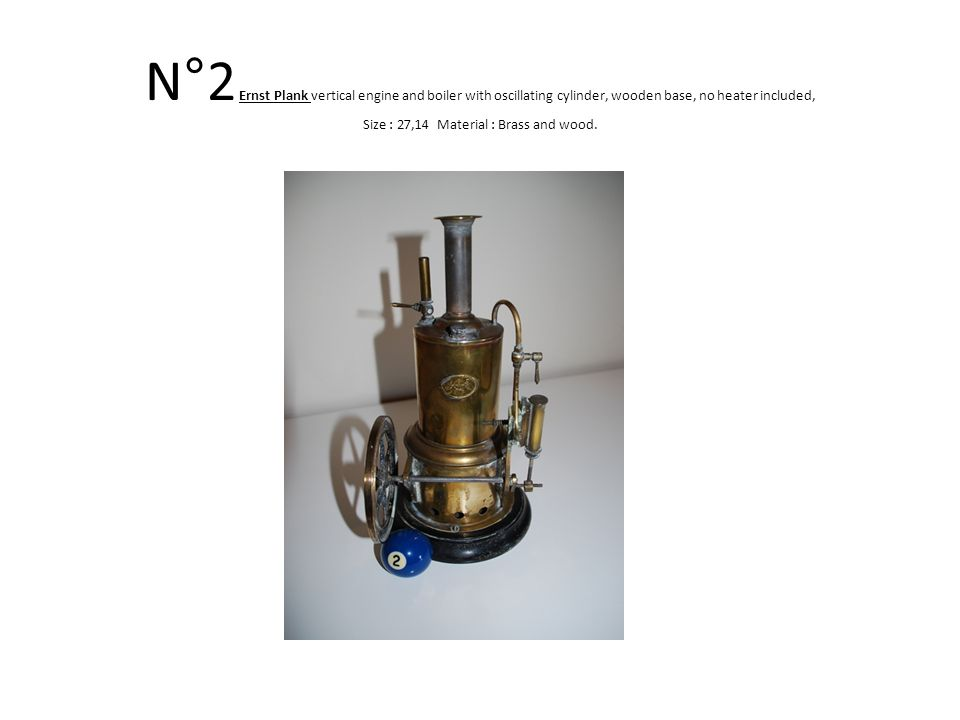 N°26 Vertical engine and boiler with curved spoke wheel, nice door and three feet.