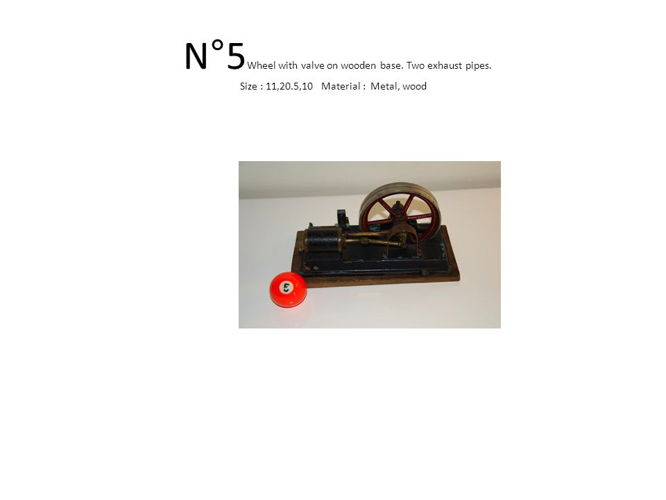 N°5 Wheel with valve on wooden base. Two exhaust pipes. Size : 11,20.5,10 Material : Metal, wood