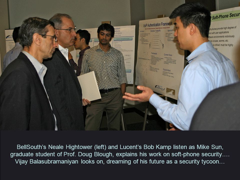 BellSouth's Neale Hightower (left) and Lucent's Bob Kamp listen as Mike Sun, graduate student of Prof.