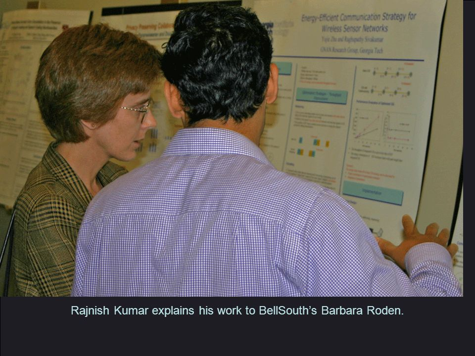 Rajnish Kumar explains his work to BellSouth's Barbara Roden.