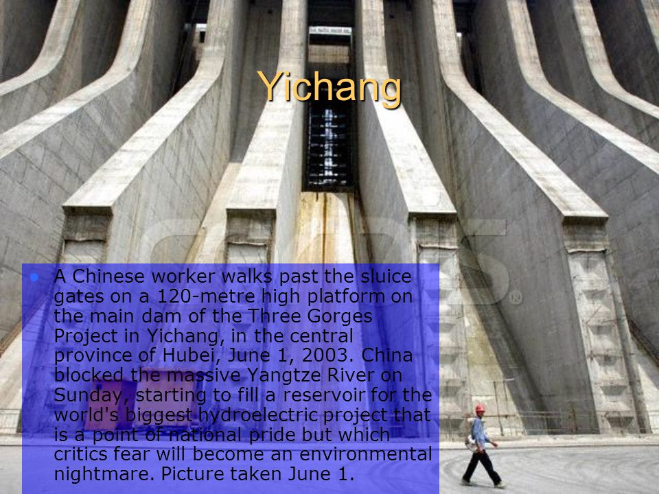 Yichang A Chinese worker walks past the sluice gates on a 120-metre high platform on the main dam of the Three Gorges Project in Yichang, in the central province of Hubei, June 1, 2003.