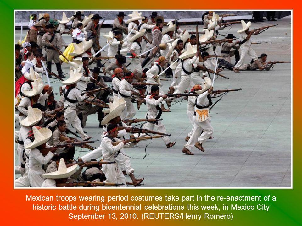 Mexico s President Felipe Calderon waves the national flag in Mexico City on September 15, 2010.