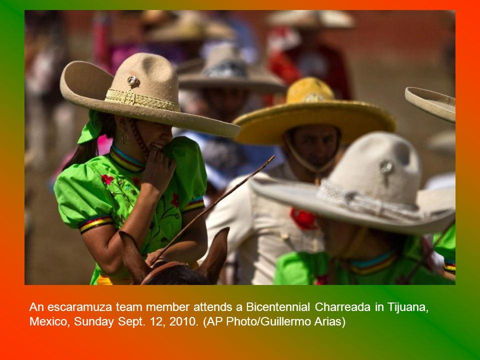 A charro performs during a Bicentennial Charreada in Tijuana, Mexico, Sunday Sept.
