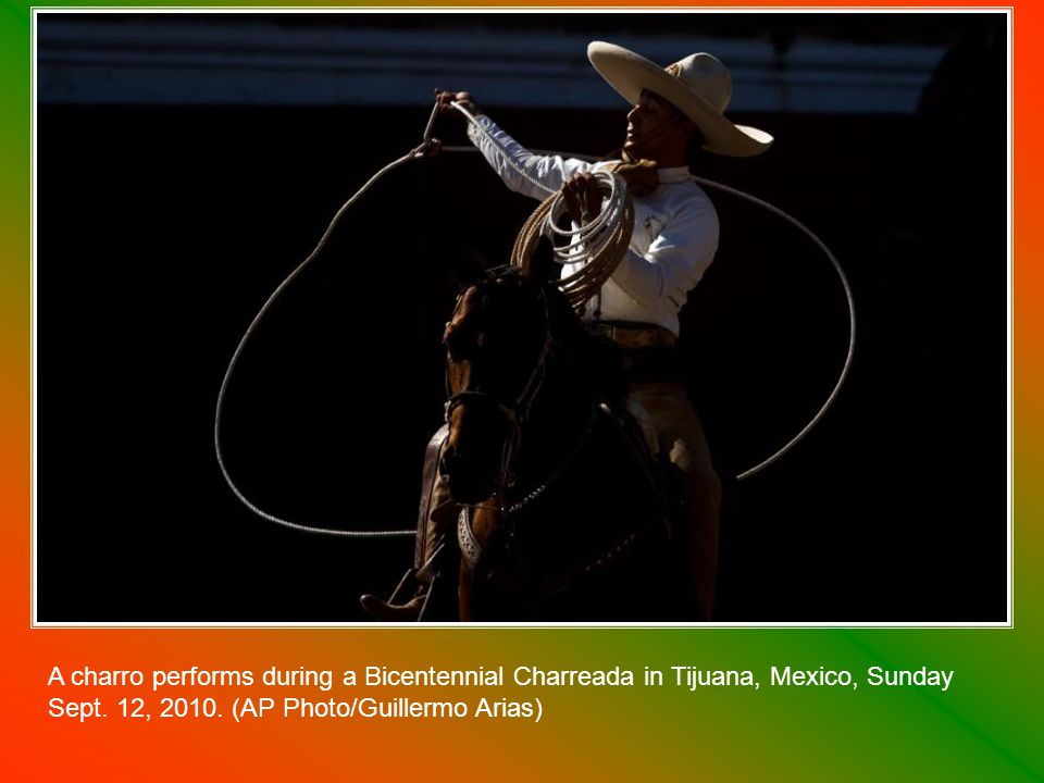 A performer representing America rides on a float during a parade as Mexico marks its 200th anniversary in Mexico City on September 15, 2010.