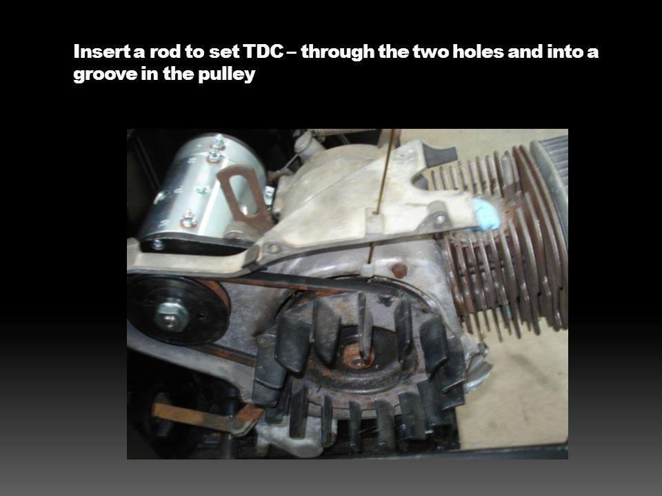 Insert a rod to set TDC – through the two holes and into a groove in the pulley