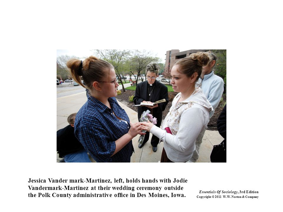 Jessica Vander mark-Martinez, left, holds hands with Jodie Vandermark-Martinez at their wedding ceremony outside the Polk County administrative office in Des Moines, Iowa.