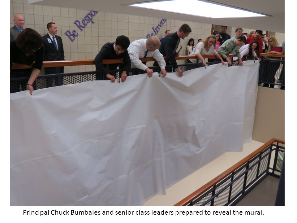 Principal Chuck Bumbales and senior class leaders prepared to reveal the mural.