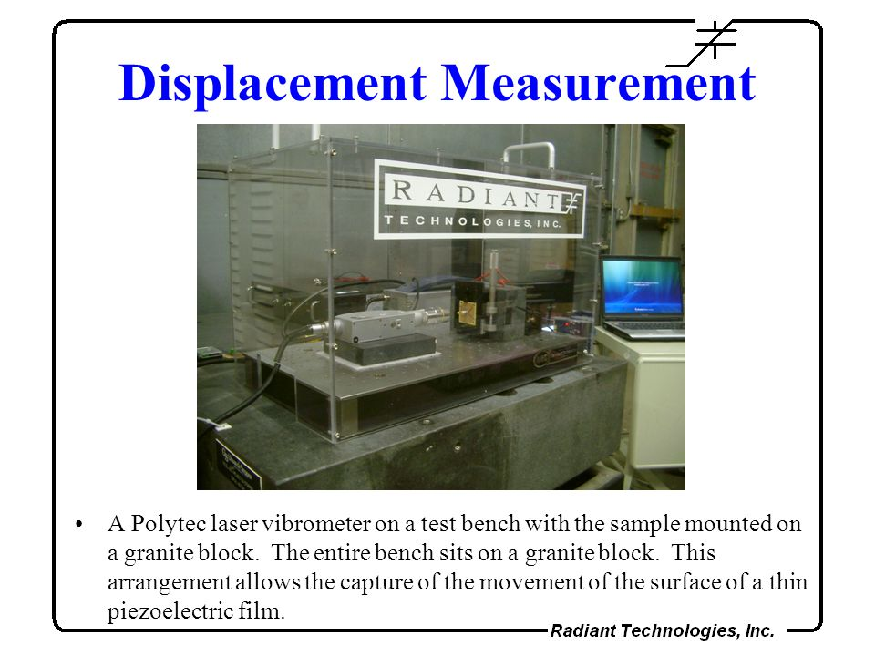 Displacement Measurement A Polytec laser vibrometer on a test bench with the sample mounted on a granite block.
