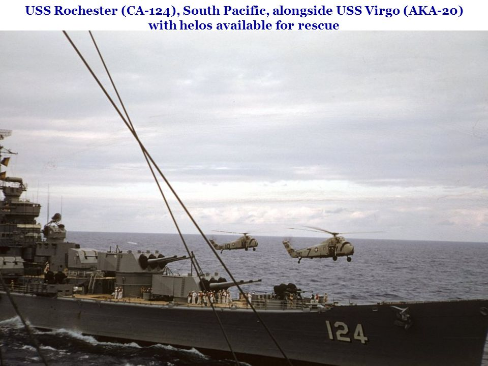 USS Rochester (CA-124), South Pacific, alongside USS Virgo (AKA-20) with helos available for rescue