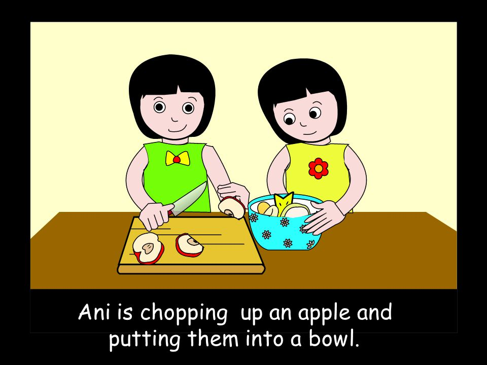 Ani is chopping up an apple and putting them into a bowl.