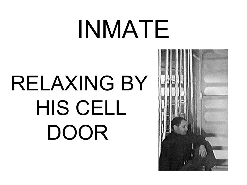 INMATE RELAXING BY HIS CELL DOOR