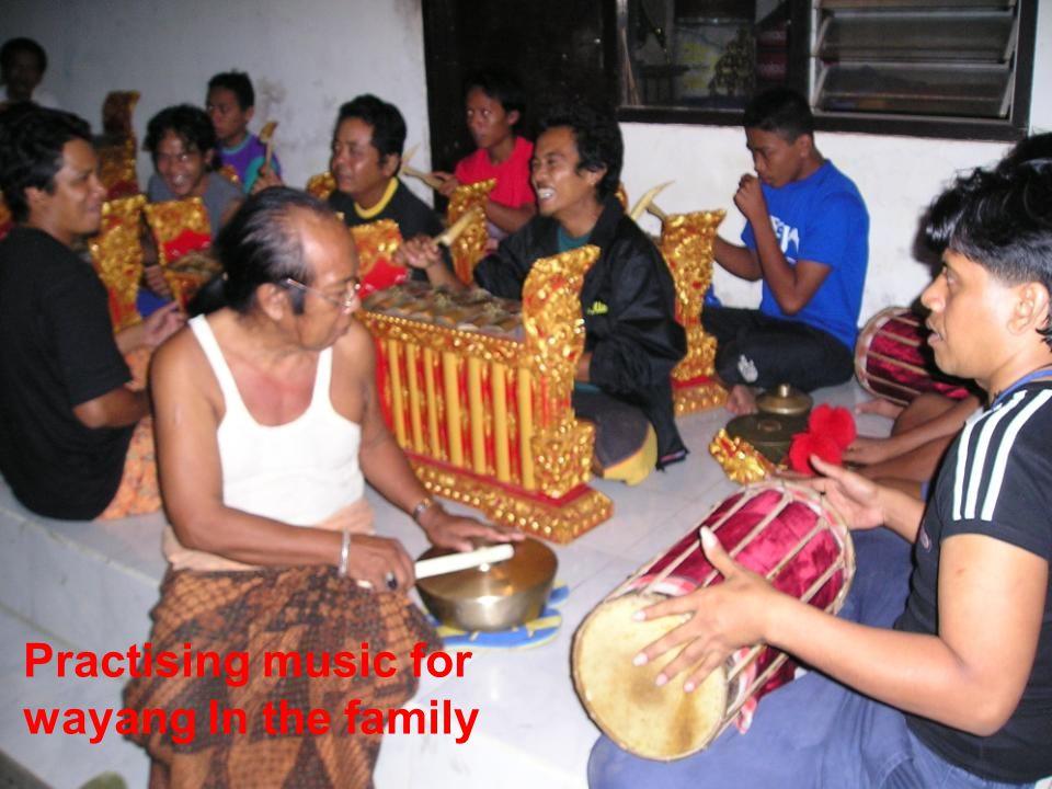 Practising music for wayang ln the family
