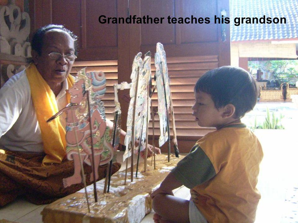 Grandfather teaches his grandson