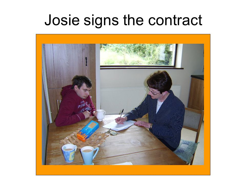 Josie signs the contract