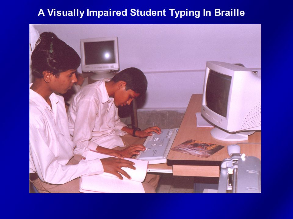 A Visually Impaired Student Typing In Braille