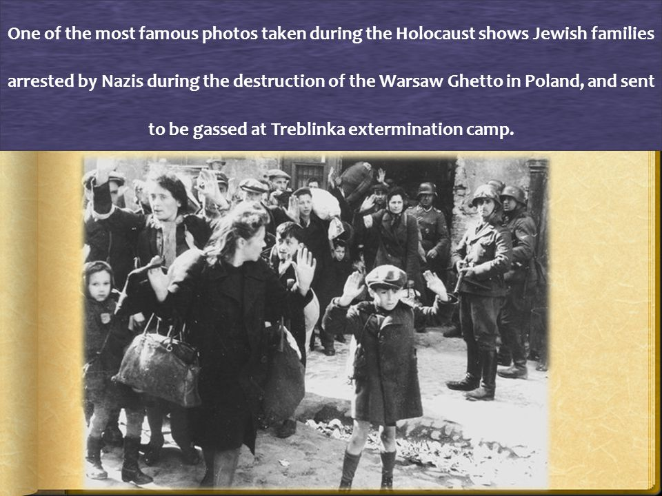 A Jewish man wearing the yellow star walks along a street in Germany.