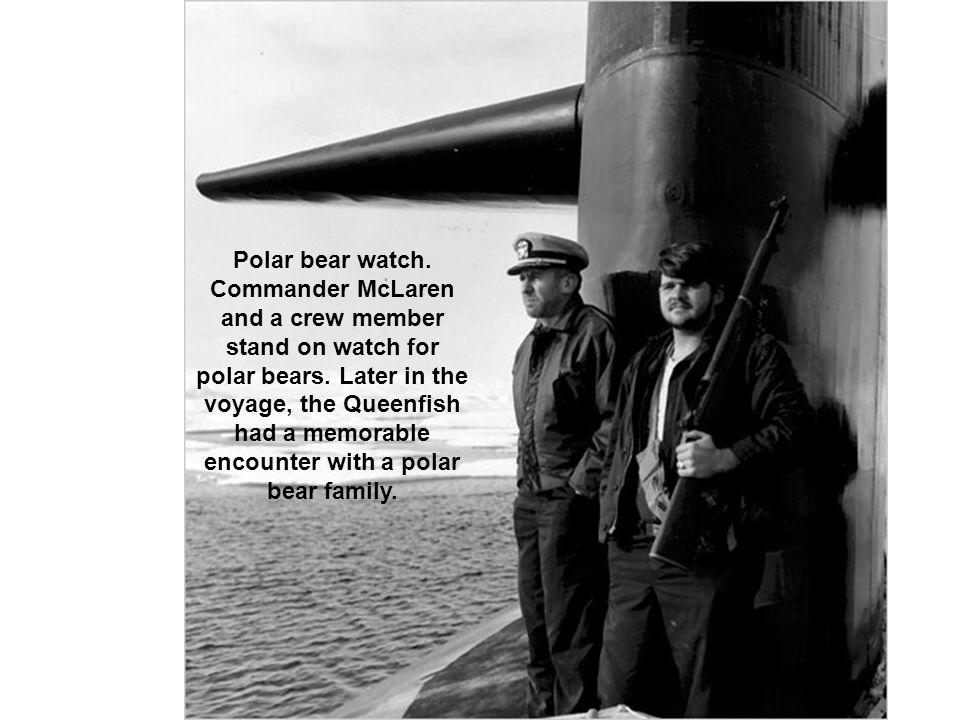 Polar bear watch. Commander McLaren and a crew member stand on watch for polar bears.