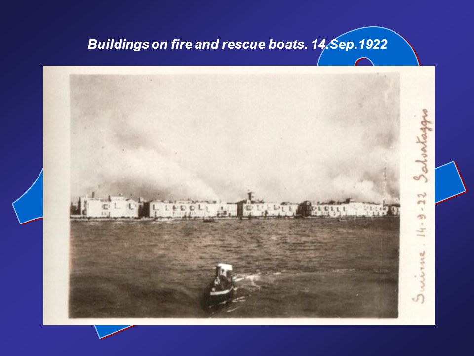 Buildings on fire and rescue boats. 14.Sep.1922