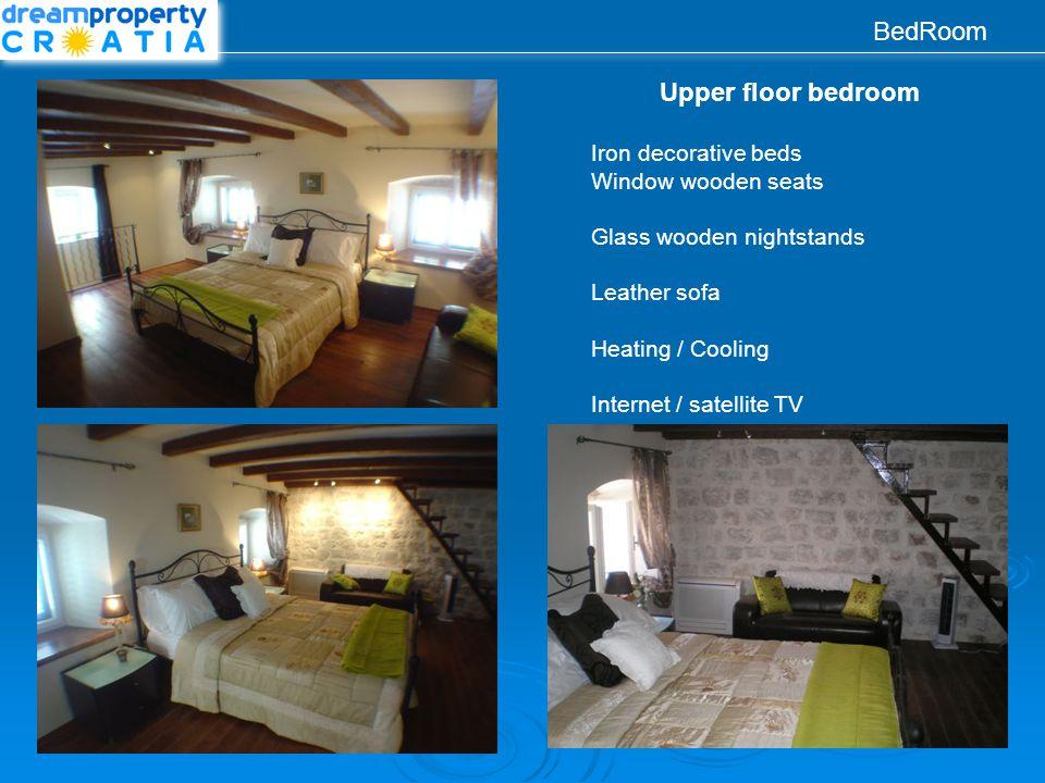 BedRoom Upper floor bedroom Iron decorative beds Window wooden seats Glass wooden nightstands Leather sofa Heating / Cooling Internet / satellite TV
