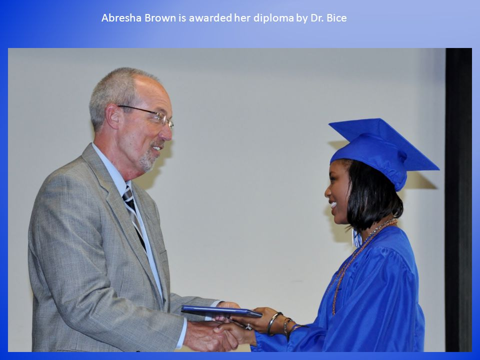Abresha Brown is awarded her diploma by Dr. Bice